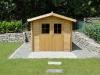 Gartenhütte umrandet mit Muschelkalk-Mauersteinen aus Garitz